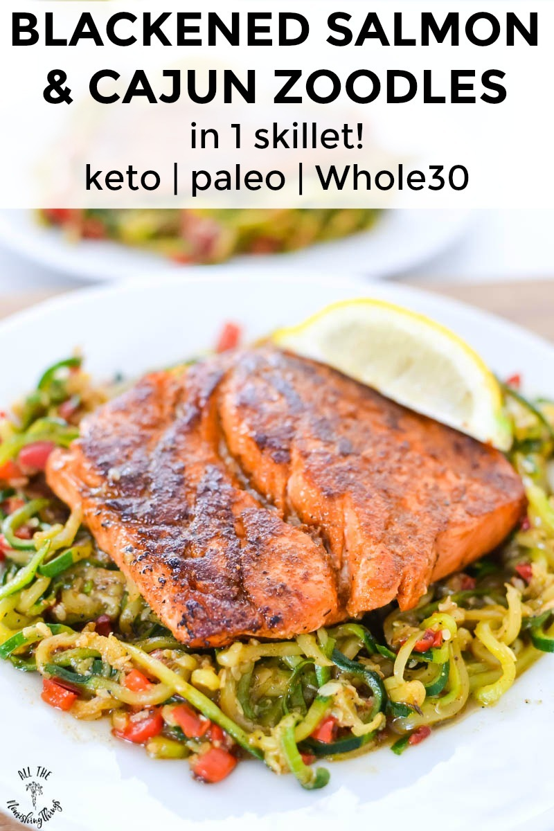 blackened salmon and cajun zoodles on a white plate with text overlay