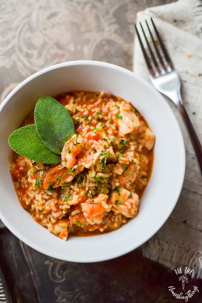 white bowl of instant pot jambalaya with a fork