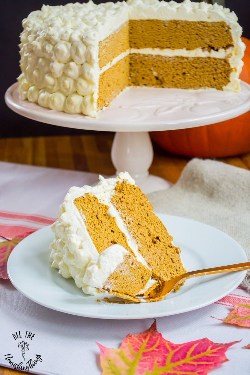 grain-free pumpkin spice cake on a white plate with a fork