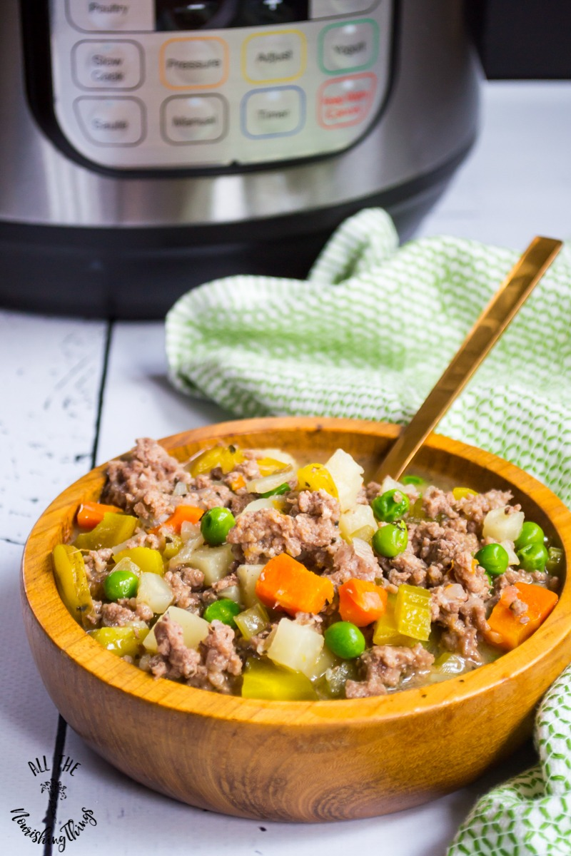 wooden bowl of instant pot vegetable beef stew