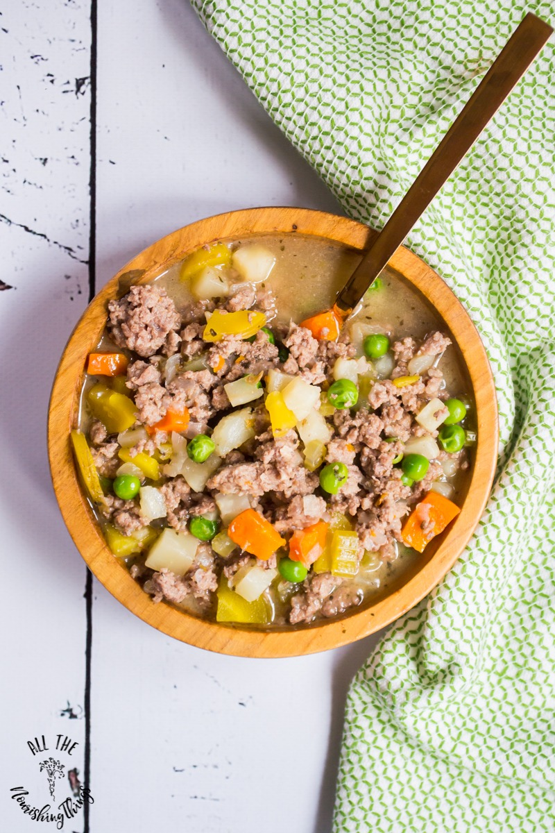 wooden bowl of potato-free keto low-carb instant pot vegetable beef stew with green towel