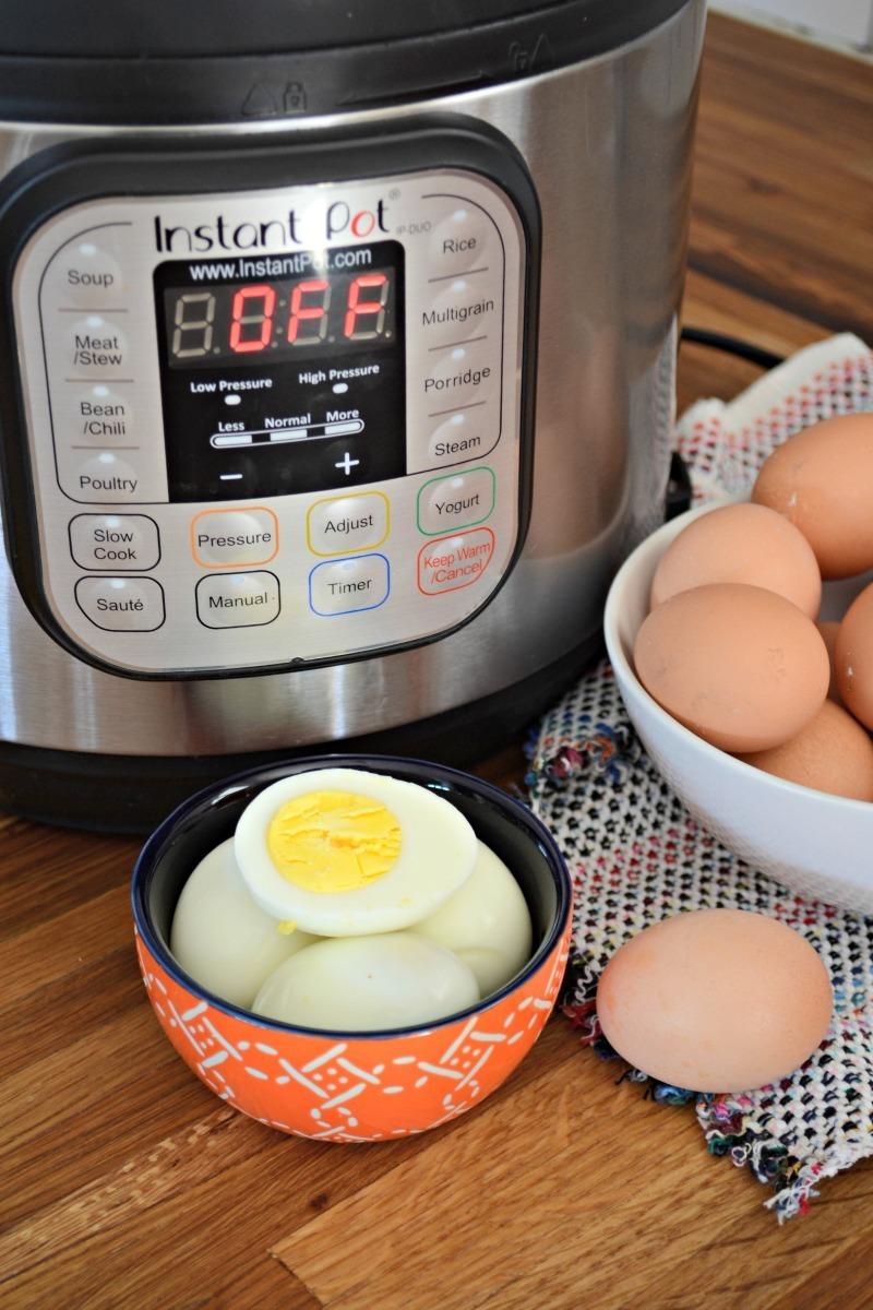 no fail instant pot hard boiled eggs in orange bowl