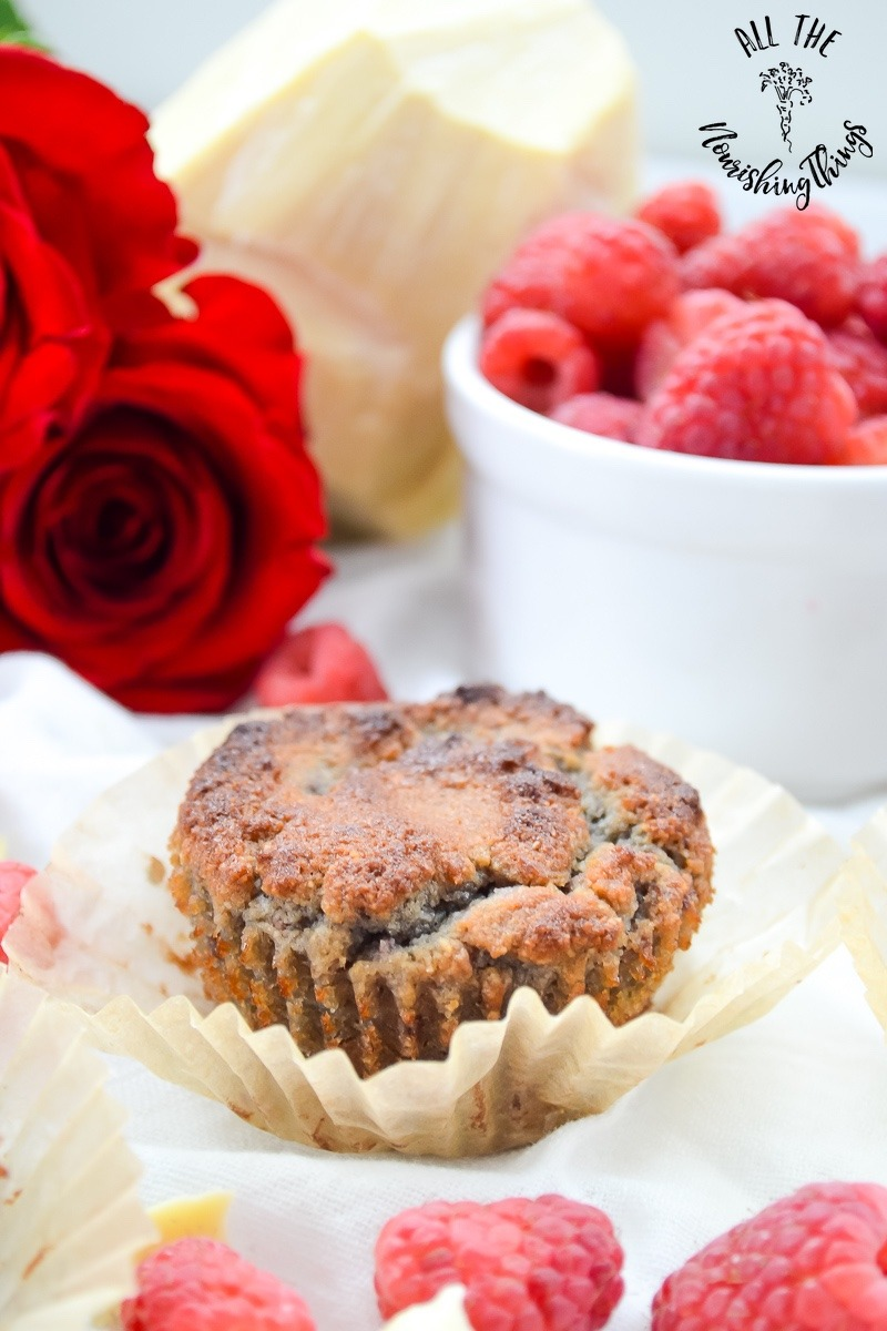 ket white chocolate raspberry muffin with raspberries and red roses