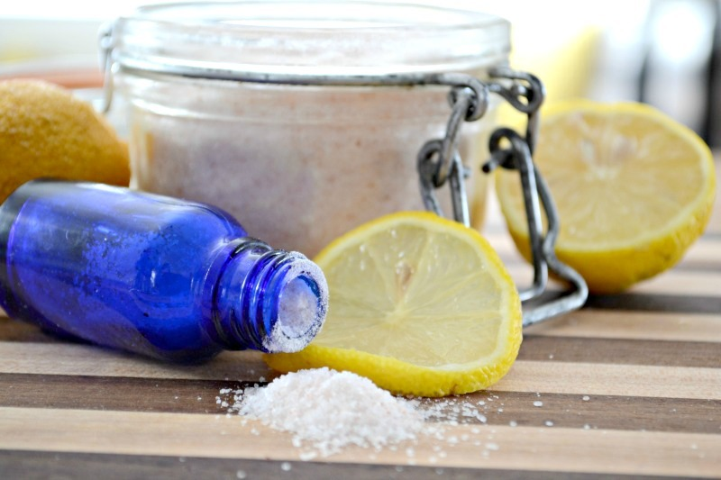 cobalt blue bottle with salt and lemons