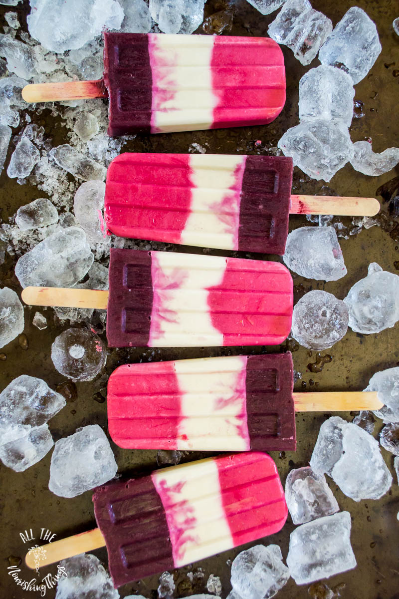 pink and purple probiotic berry popsicles with ice