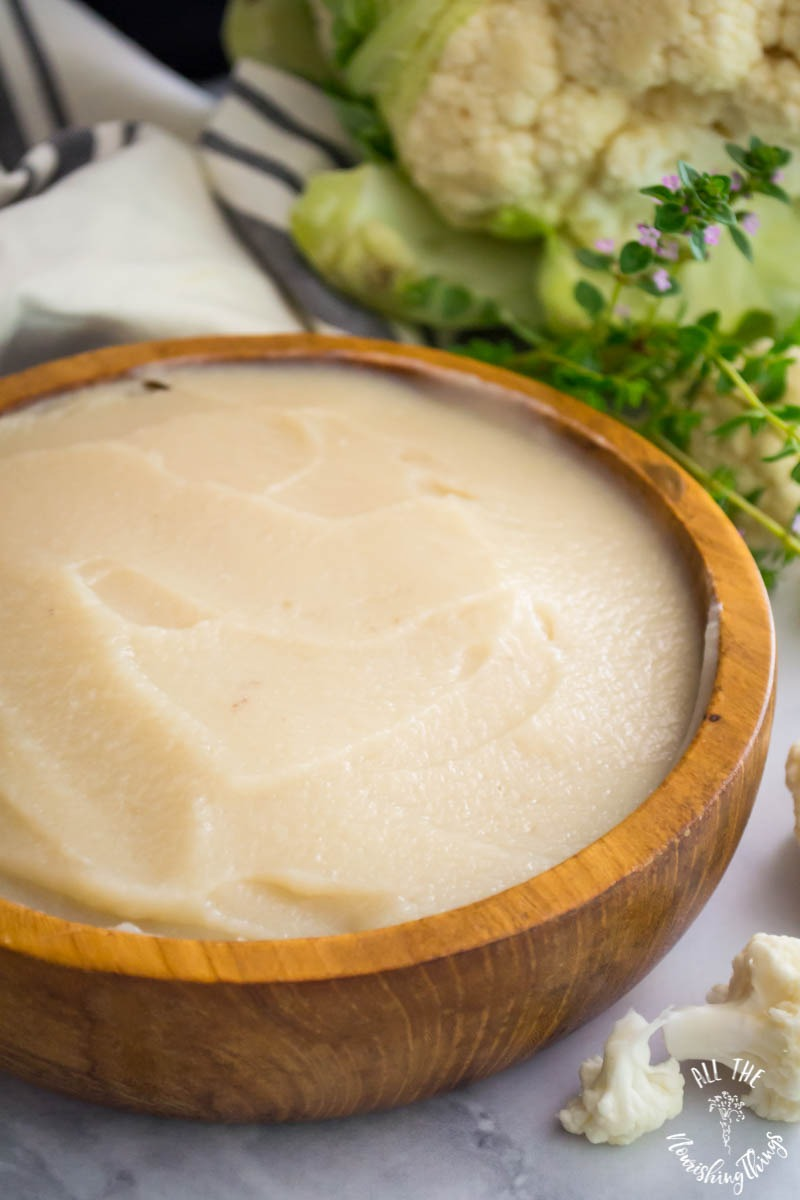 wooden bowl of instant pot cauliflower cream