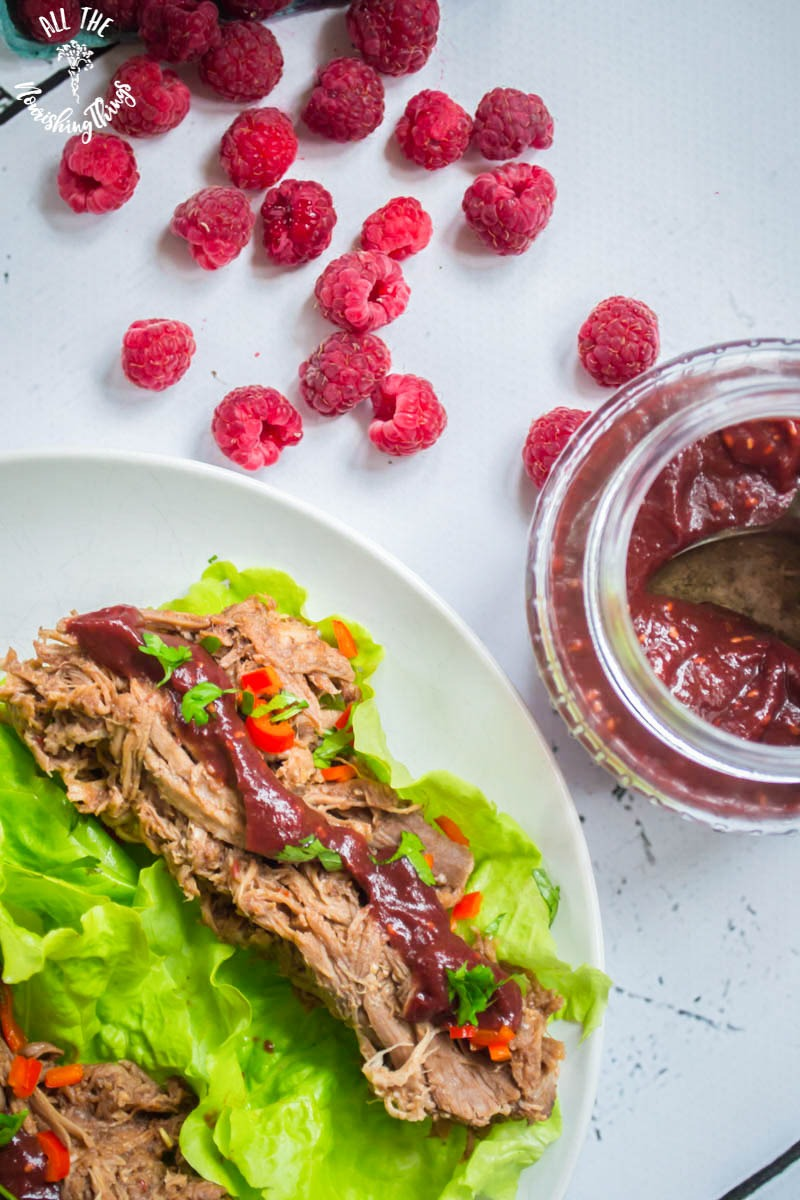 raspberry chipotle pulled pork on lettuce with fresh raspberries