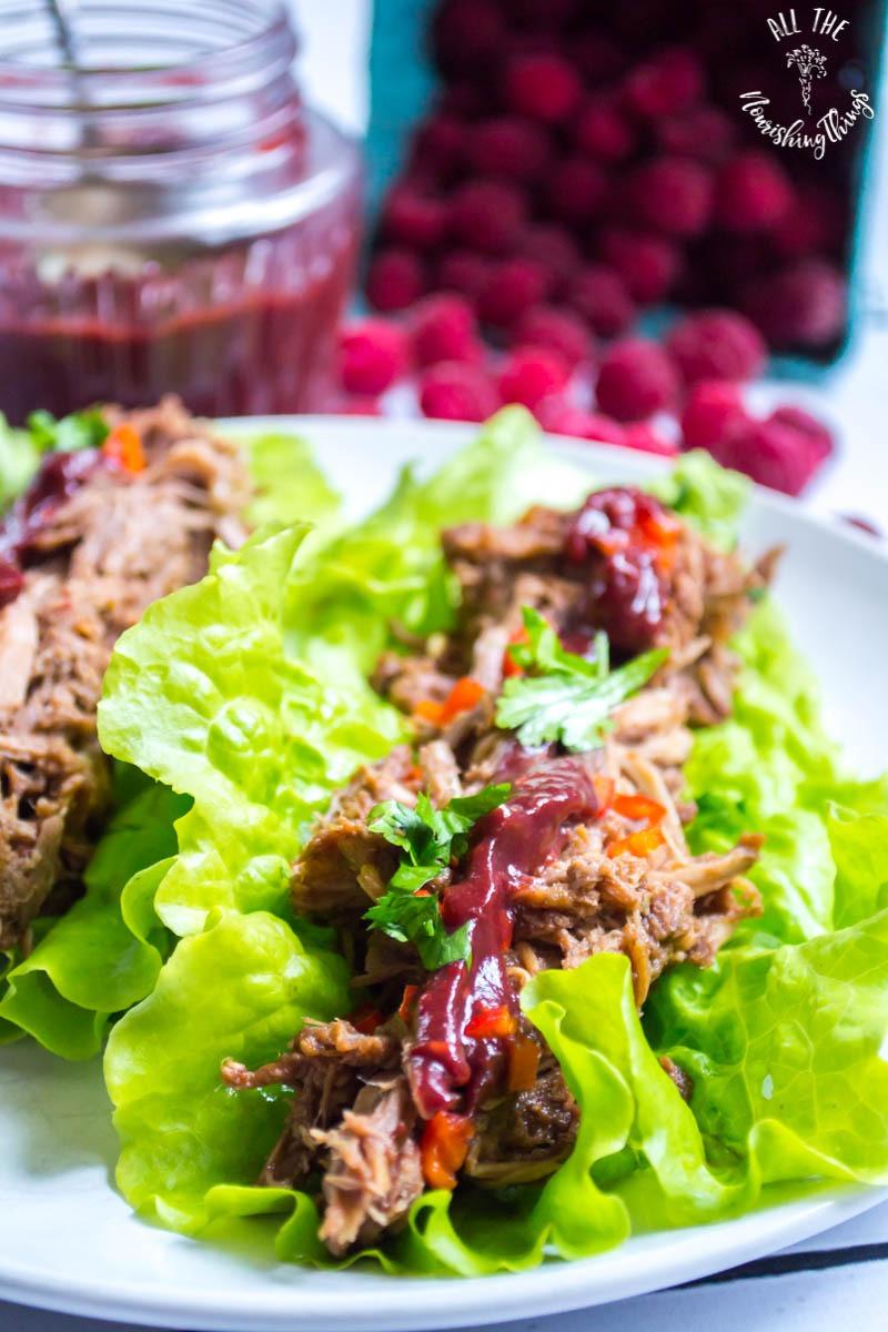 instant pot raspberry chipotle pulled pork on lettuce leaf