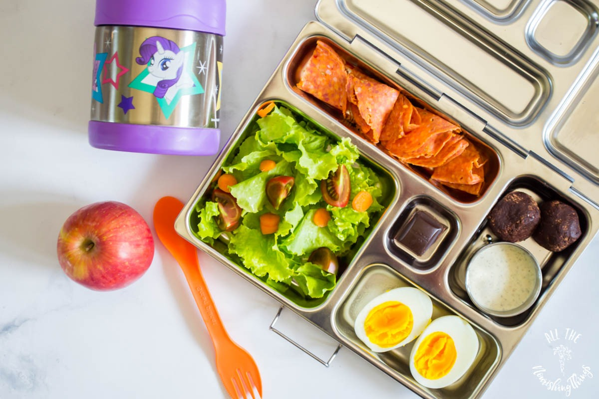 planetbox bento box with salad and boiled egg and pepperoni