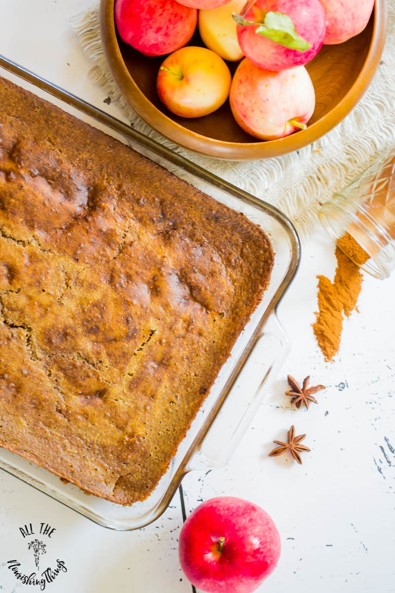 soaked gluten-free apple breakfast cake with bowl of apples