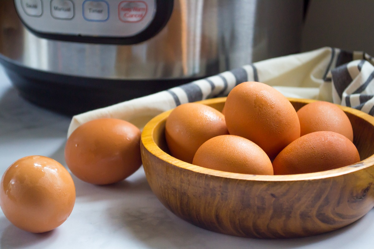 wooden bowl of brown farm eggs and instant pot