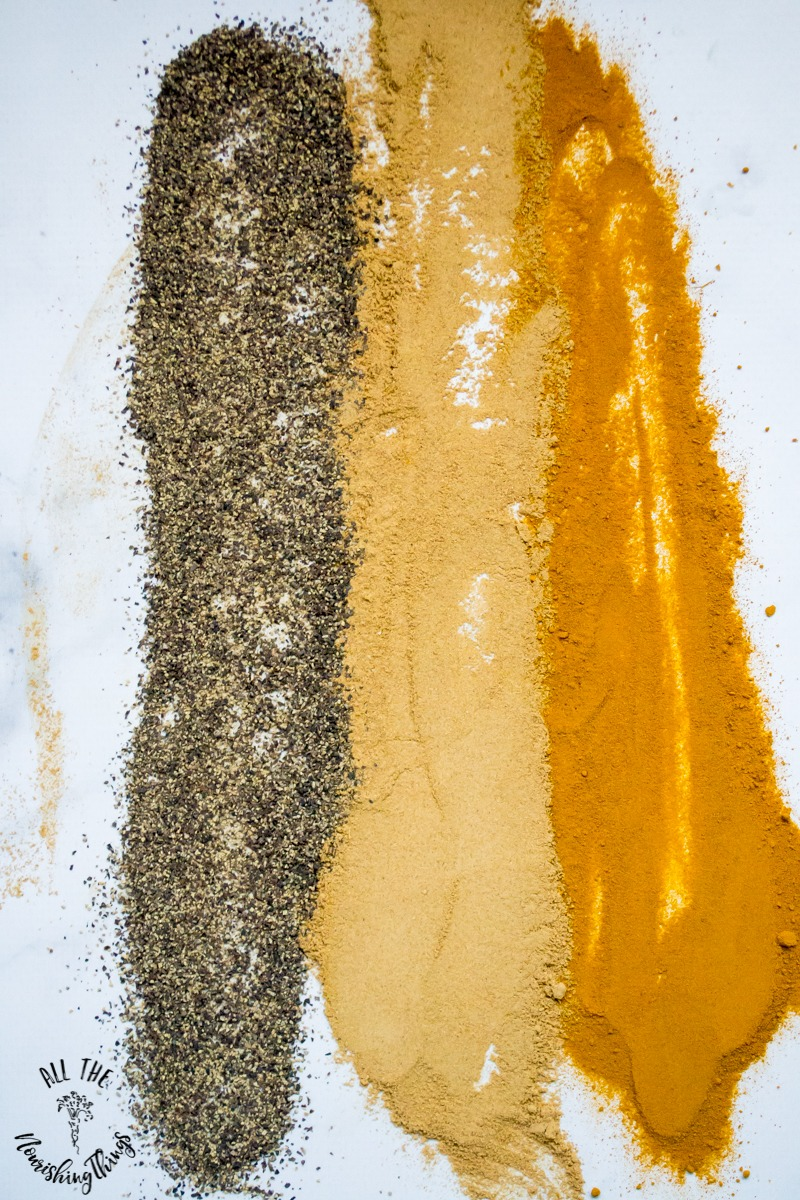 ground black pepper and ground ginger and ground turmeric spread out