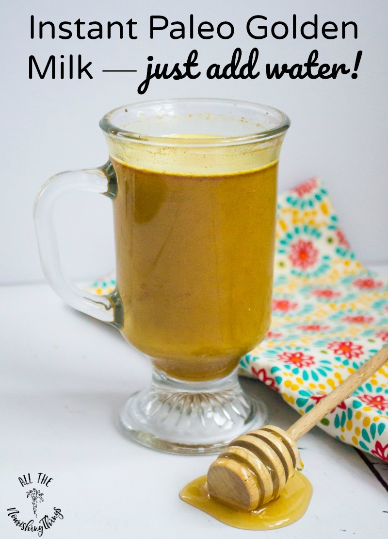 clear mug of instant paleo golden milk with text overlay