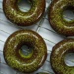 keto matcha moringa baked donuts with chocolate glaze on a cooling rack