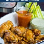whole30 and keto instant pot buffalo wings in white dish with dipping sauces