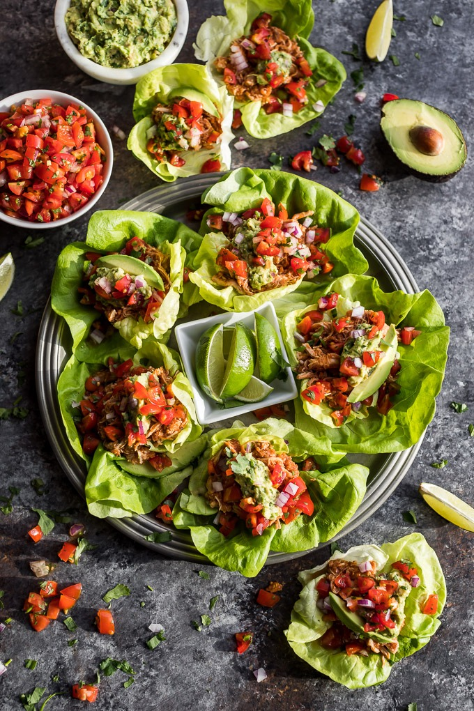 chicken tinga lettuce tacos with tomatoes and avocado