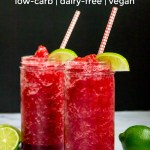 two cherry lime slushies with straws and lime wedges and text overlay