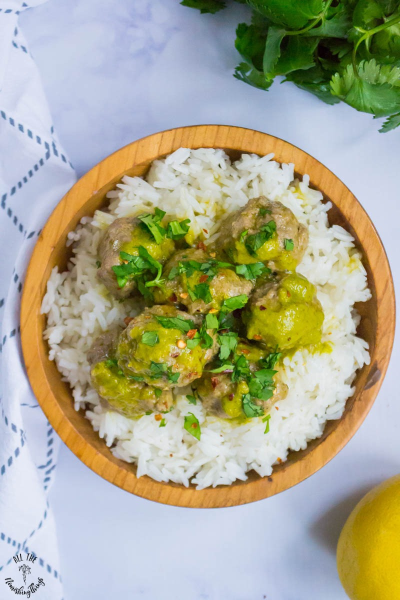 wooden bowl of rice and instant pot cilantro meatballs