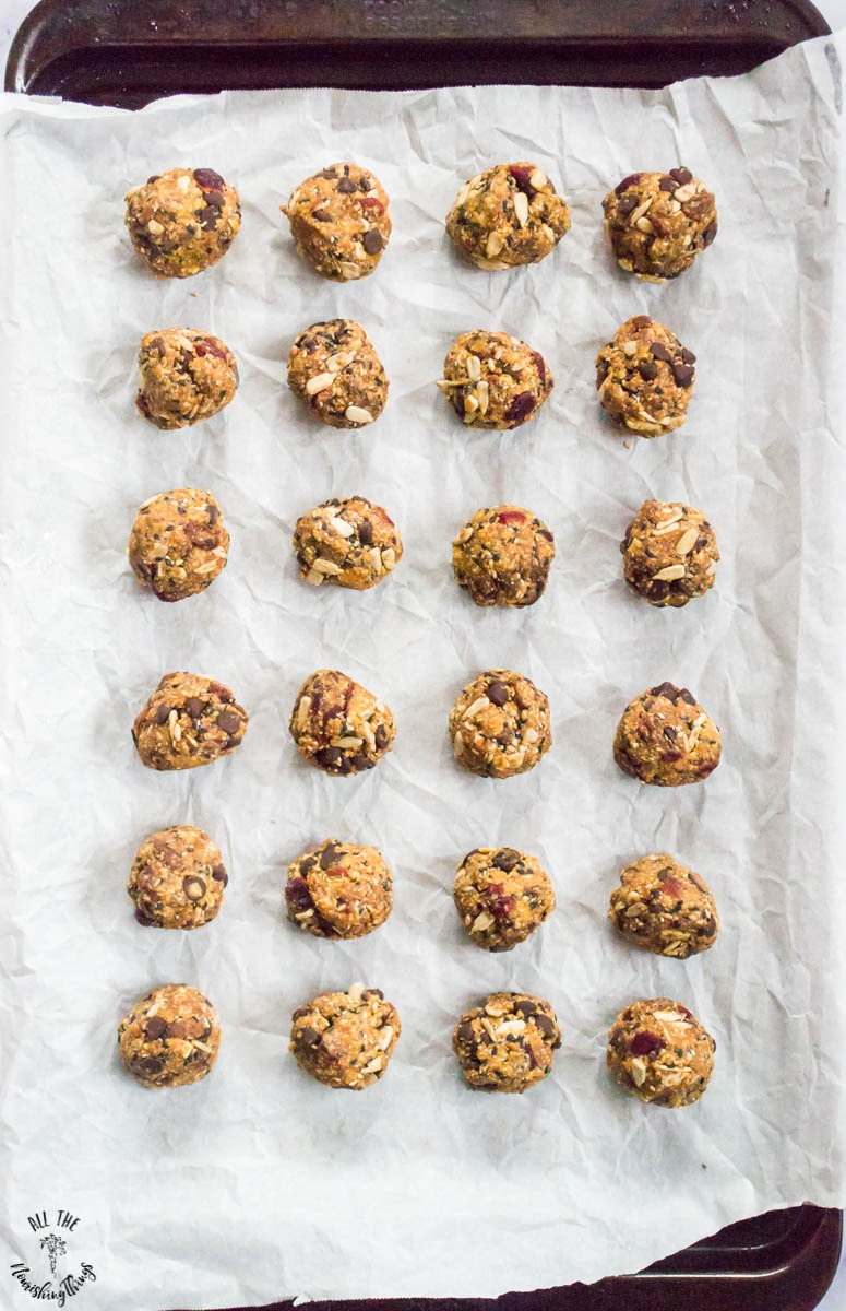 paleo no-bake granola bites on a cookie sheet