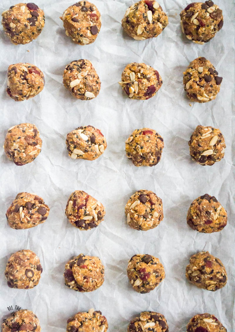 round paleo no-bake granola bites on a cookie sheet