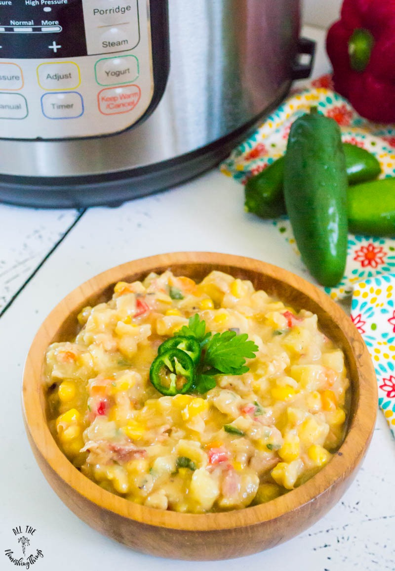 wooden bowl of dairy-free instant pot corn chowder with instant pot in the background