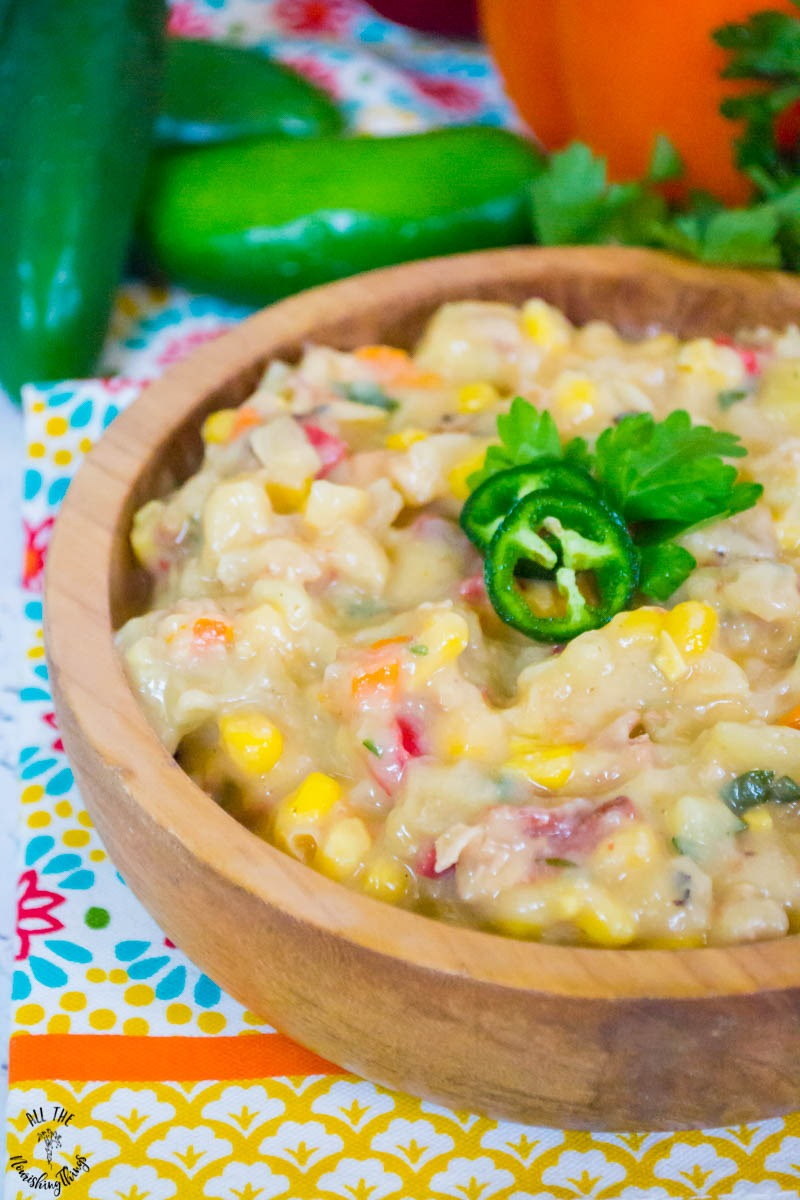 close-up image of dairy-free instant pot bacon jalapeno corn chowder garnished with jalapeno slices