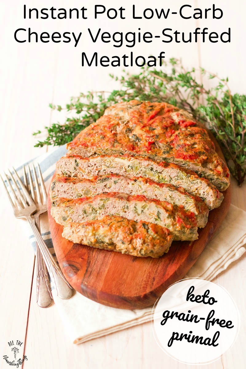 sliced low-carb instant pot cheesy veggie-stuffed meatloaf on wooden cutting board with text overlay