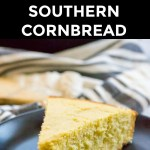 slice of gluten-free southern cornbread on black plate with text overlay