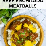 wooden bowl with instant pot beef enchilada meatballs with cheese sauce and cilantro