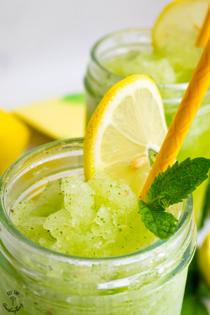 glass of green keto frozen mint lemonade that looks frozen and slushy