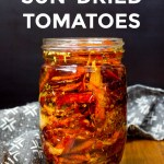 jar of bright red homemade sun-dried tomatoes