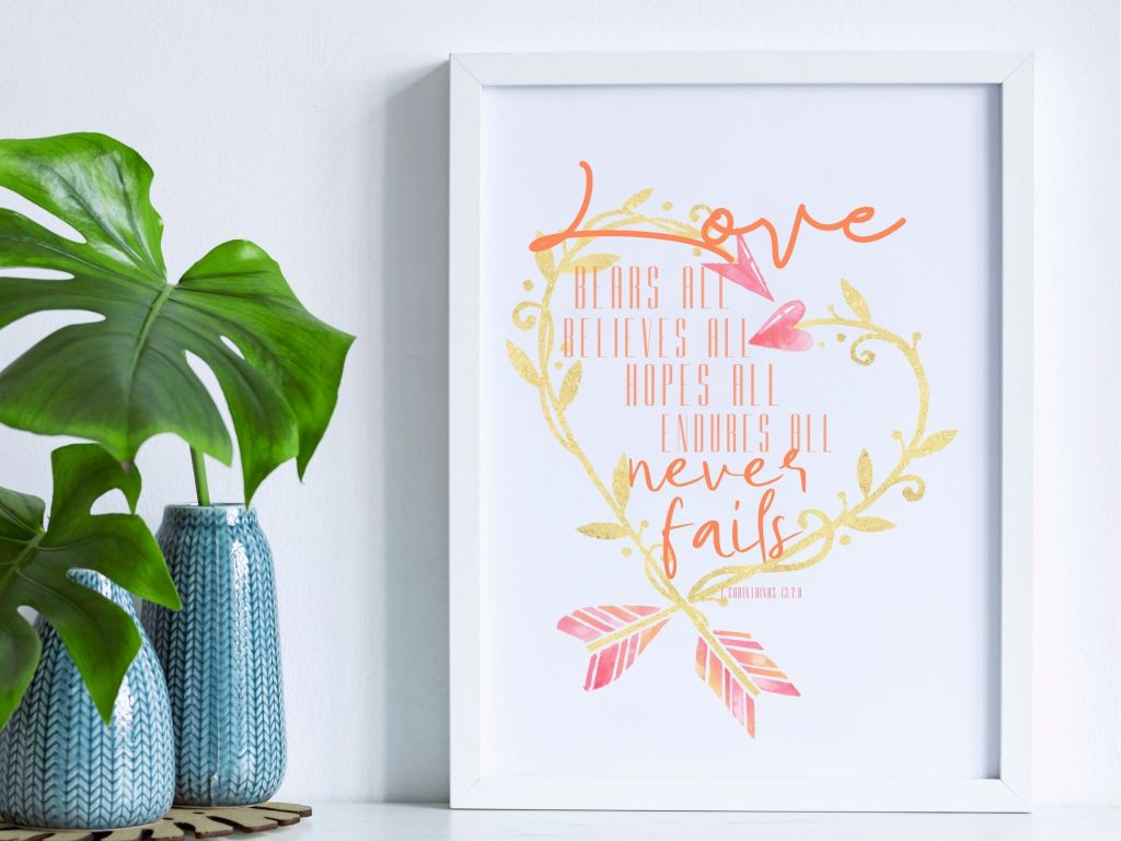 Love never fails Free Digital Download printable. Heart Arrow wreath with 1 Corinthians 13 verse in corals and pinks