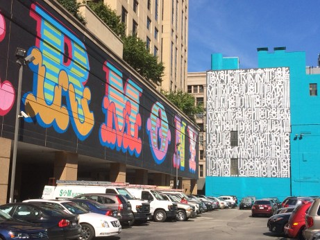 Street murals wrap the parking lot at Wabash Avenue and Harrison Street.
