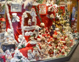 A store window is stuffed with Christmas teddy bears