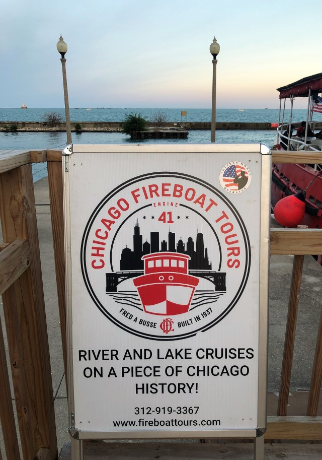 A sign for Chicago Fireboat Tours, phone number 312-919-3367, website www.fireboattours.com