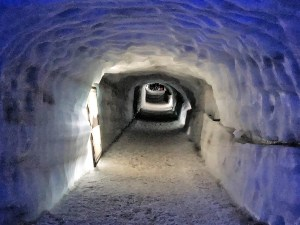 An icy tunnel is wide enough for several people to pass through