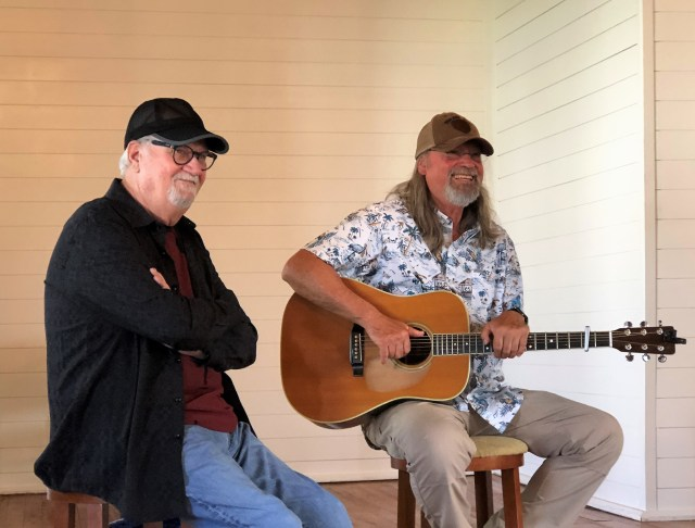 Songwriters Roger Murrah and Scott Anders share a laugh.