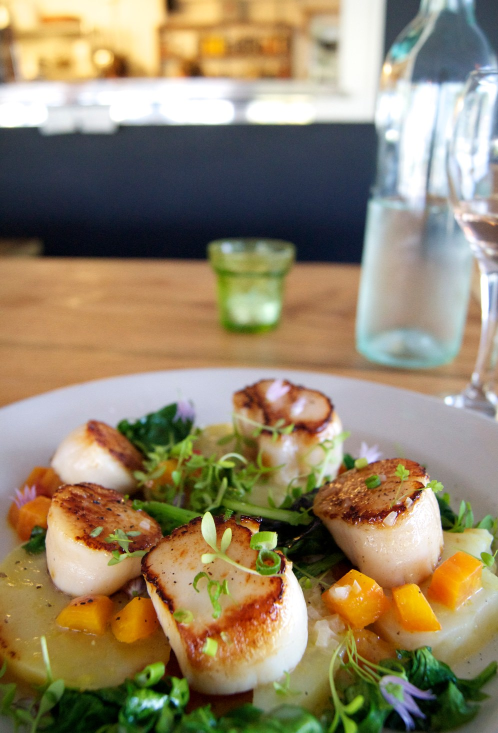 seared scallops with marinated potatoes, beets, and braised greens