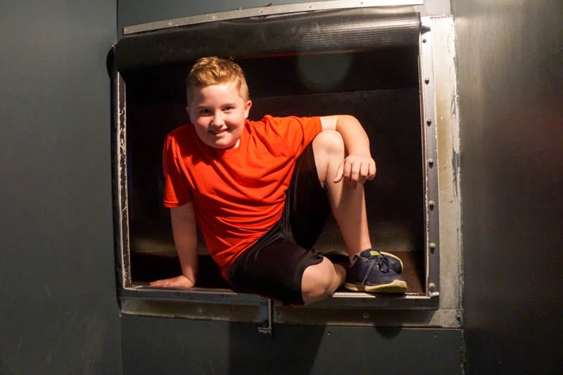 Crawling through a duct at the International Spy Museum