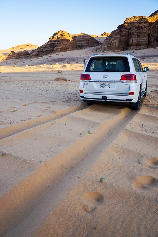 Driving through sand dunes near Al-Ula