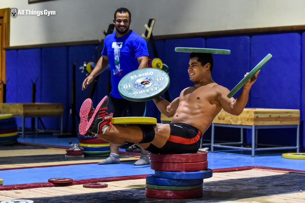 Mohamed Ehab Plate Balancing on Head Abs Core Workout
