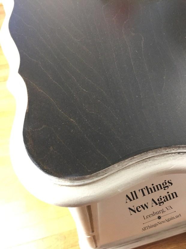 Top of vintage buffet | black stain on wood grain