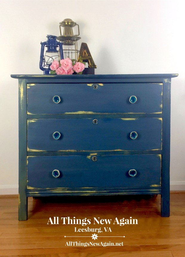 vintage dresser painted blue with gold trim