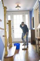 Black man cleaning