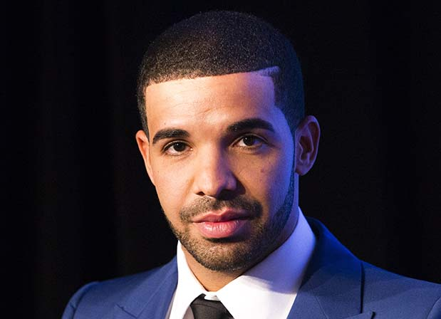 Rapper Drake looks on during an announcement that the Toronto Raptors will host the NBA All-Star game in Toronto, September 30, 2013. Toronto was selected as the host of the National Basketball Association's (NBA) 2016 All-Star Game, marking the first time the showcase event will be held outside of the United States, the league said on Monday. REUTERS/Mark Blinch (CANADA - Tags: SPORT BASKETBALL ENTERTAINMENT) - RTR3FFZO