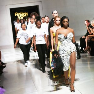 Tiwa Savage walks the runway for Naomi Campbell's