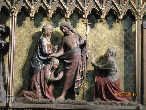 Scenes from the life of Christ, the risen Christ appears to the holy women, Wood painted panel inside Notre Dame Cathedral. Image by Lysandra Furstenberg