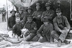 Members of the NZ Rifle Brigade with Caesar. Source Auckland War Memorial Museum