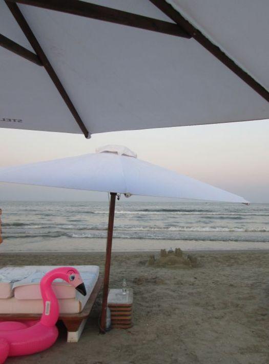 pink flamingo, sand castle, beach umbrella by the sea @PatFurstenberg