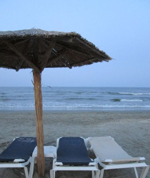 after sunset beach umbrella by the sea @PatFurstenberg